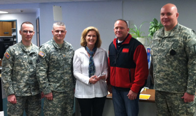Sarah Hollander with members of the Iowa National Guard
