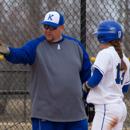 Head Coach Joe Yegge gives Shelby Crist some tips for running the bases