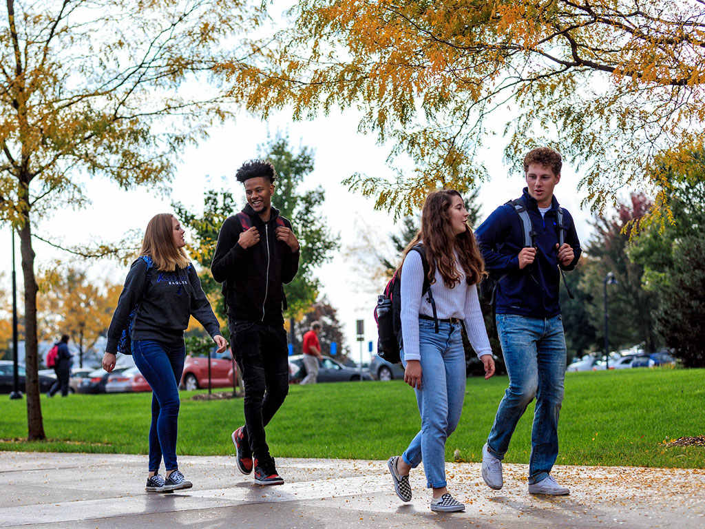 students-walking-outside-featured
